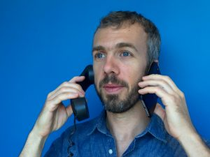 """NPR's Rob Byers demonstrates the proper positioning for a guest """"synching"""" himself (doing a phone interview while recording himself in good quality on a smart phone)"""